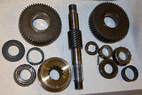 Both gears, drive cone, collars, shifter, nuts and seals are new; shaft, pin, bearings and their inner races are old.