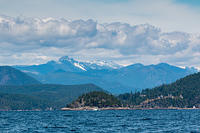 Sunshine Coast as is - seascape, mountainscape, sun, clouds. Entrance to Agamamnon Channel ahead.